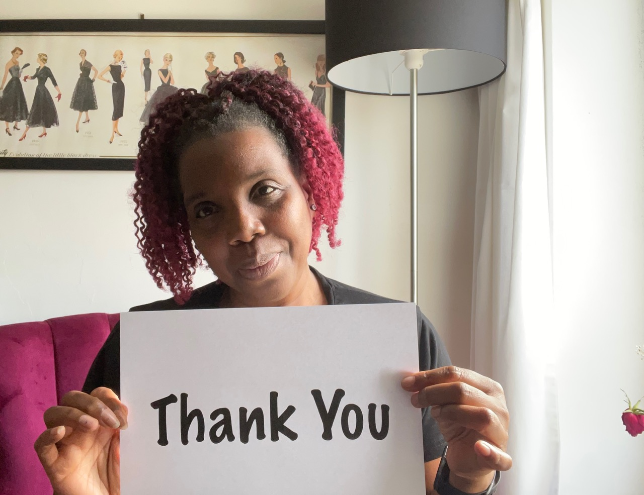 Claire With A Thank You Sign